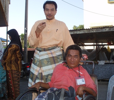 husam-with-a-man-on-the-wheelchair.jpg