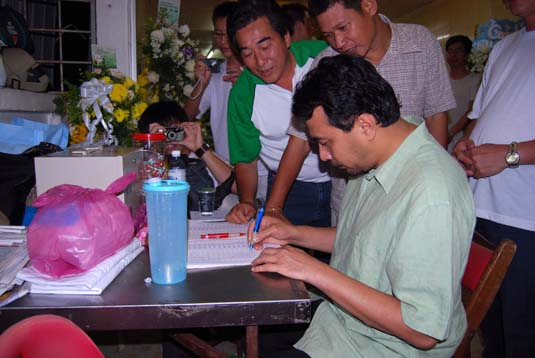 husam-signing-the-book.jpg